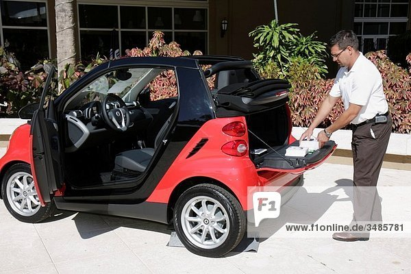 Florida  Miami  Jungle Island  Gateway to Green Exhibition  building products  services  industry  exhibitor  vendor  fair  SMART car  environment  auto  conservation  fuel efficient  ULEV  ultra low emission  man  trunk  marketing
