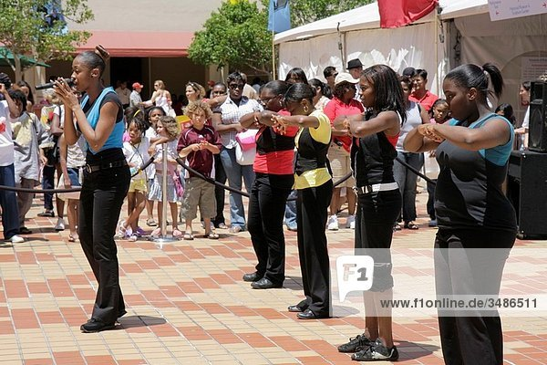 Florida  Miami  Cultural Center Plaza  Main Public Library  The Art of Storytelling International Festival  Steps in Order  hip hop  dance group  dacing  singing  Black  girl  boy  woman  teen  student  audience  multi ethnic  entertainment