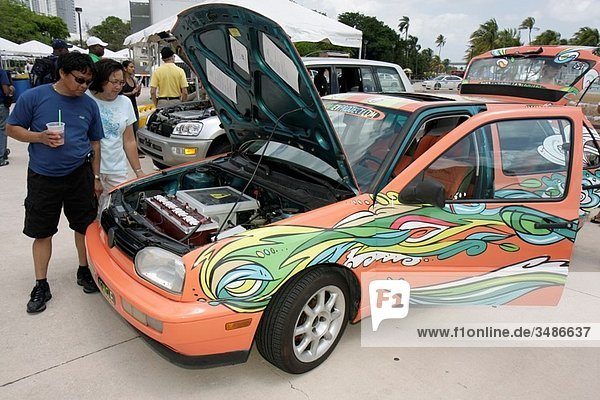 Florida  Miami  Bayfront Park  Miami Goin´ Green  eco-friendly  environment  green event  exhibitor  EV Project  electric vehicle  car  alternative fuel  Earth Day event  community fair  Asian  man  woman  couple  custom paint job