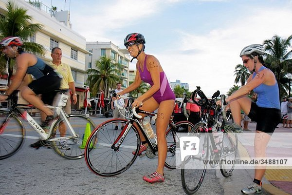 Florida  Miami Beach  Ocean Drive  Publix Family Fitness Weekend  triathlon  cycling  cyclists  bicycle  bicycles  competitors  competition  participants  woman  women  man  athlete  race  segment  helmet  motion