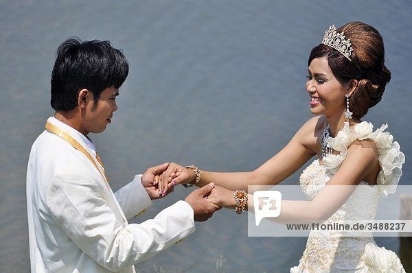 Angkor (Cambodia): newly-weds after the wedding ceremony  at Angkor Wat