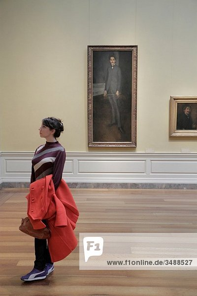 Washington DC  National Gallery of Art  West Building  museum  exhibition  James McNeill Whistler  American  ´George W Vanderbilt´  painting  portrait  woman  teen  student  red coat  looking appreciation