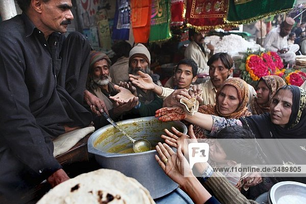 Donation of food to poor people in Pakistan