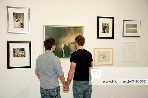 Florida  Miami Beach  Lincoln Road  ArtCenter South Florida  gallery opening  art  exhibit  exhibition  print  photograph  photography  drawing  looking  look  gay couple  homosexual  man  men  hold hands