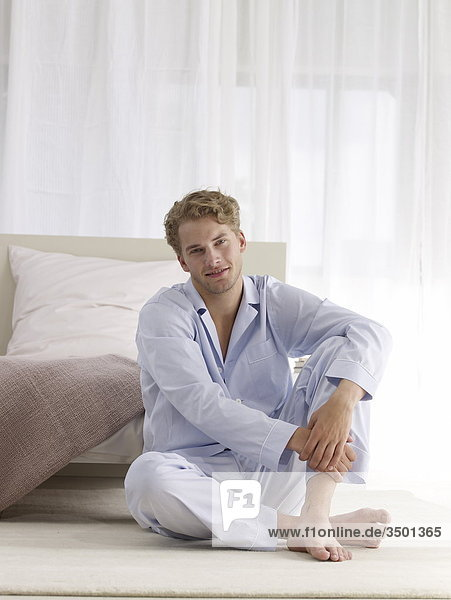 young man in pyjama