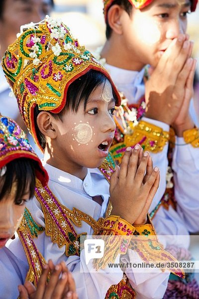Young novitiate during a ceremony in which the boyis inducted as a novice.