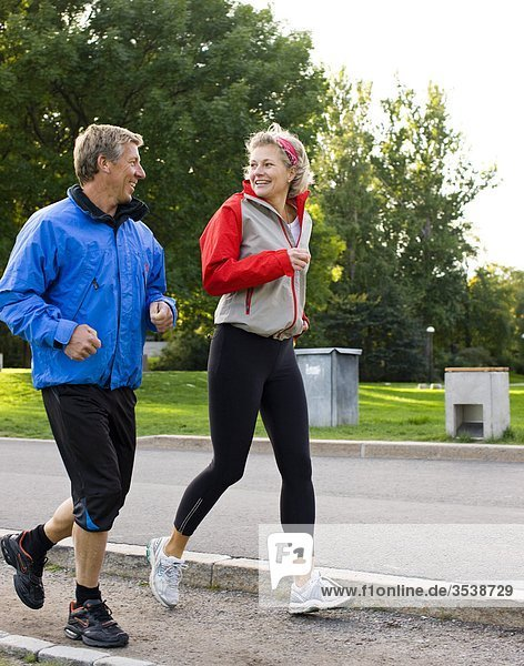 Mature couple jogging together
