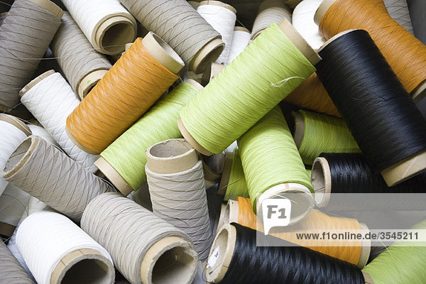 Recyclable composite textile fabrication department of factory  reels of excess coated thread