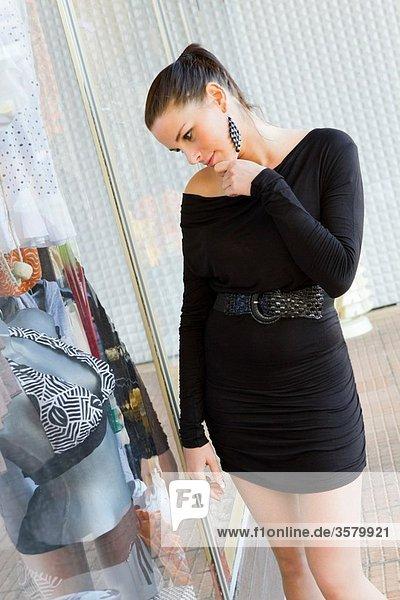 Window shopping young woman
