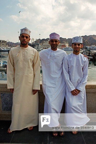 Three Omani men wearing in the traditional way