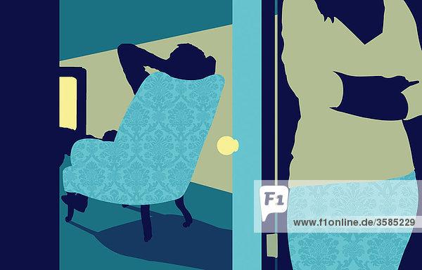 Man watching television and woman behind door