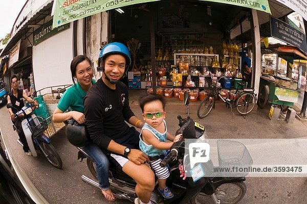 Thai family on a motorscooter  Chiang Mai  Northern Thailand