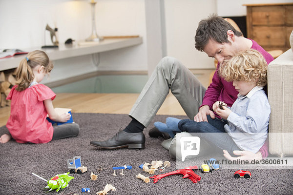 Man playing with his son in a living room