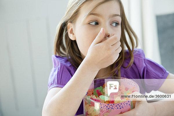Girl holding a box full of gum drops