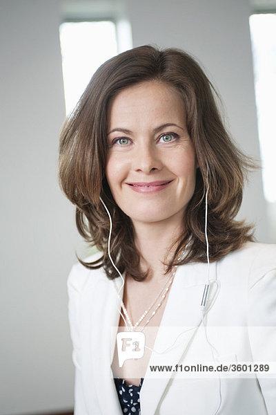 Businesswoman listening to an MP3 player
