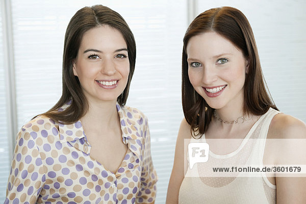 Businesswomen smiling in an office