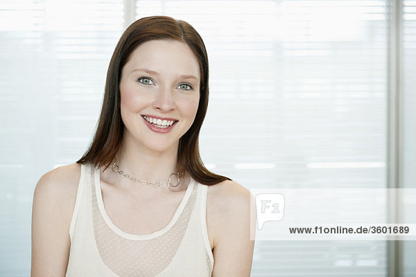 Businesswoman smiling in an office