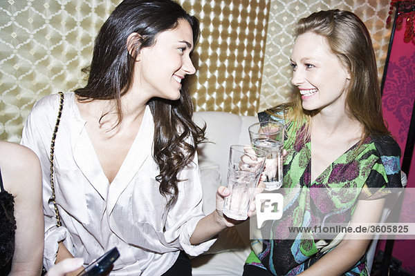 Friends chatting together at nightclub