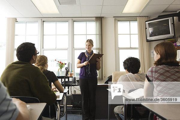 High school teacher addressing her class