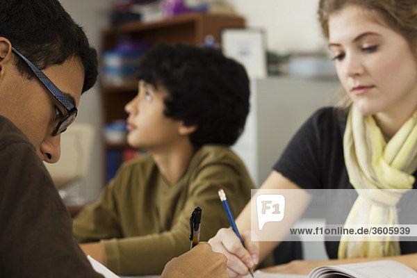 High school students completing classwork