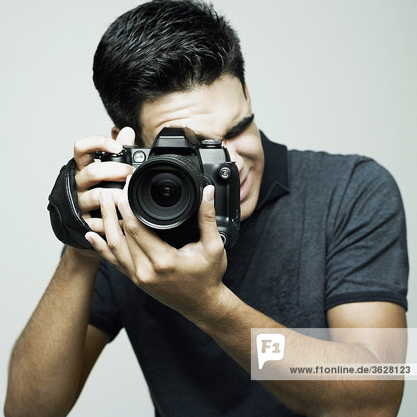 Close-up of a photographer taking a photograph