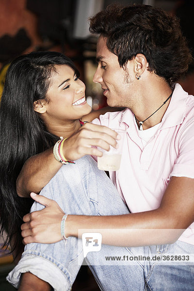 Close-up of a young couple looking at each other and smiling