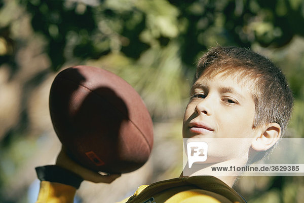 Portrait of a boy holding a rugby ball