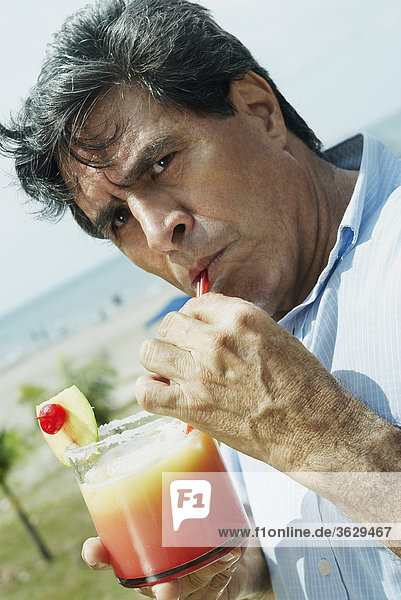 Portrait of a mature man drinking juice