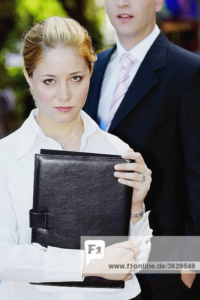 Portrait of a businesswoman standing with a businessman