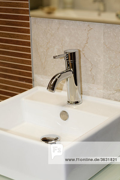 Close-up of faucet on a bathroom sink