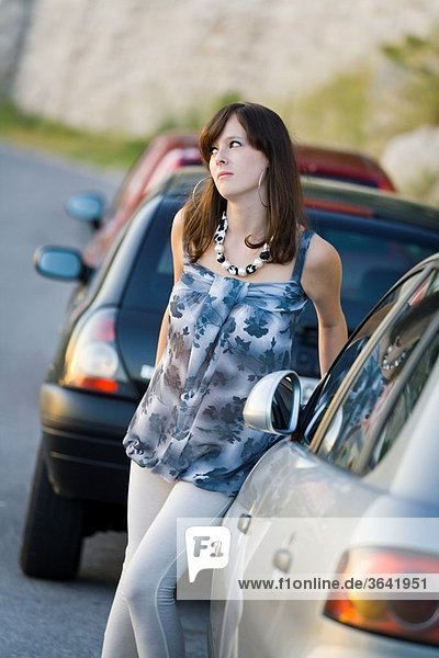 Pretty young woman and parked cars