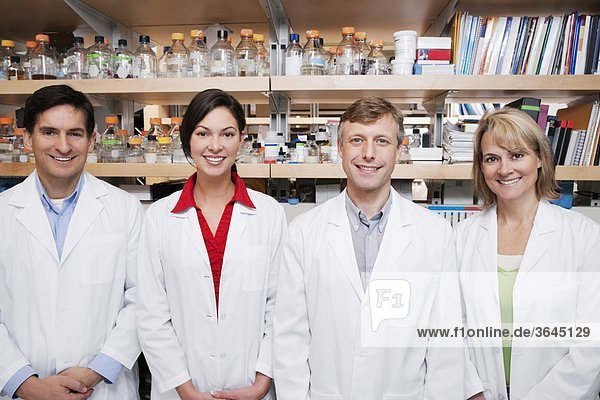 Portrait of four doctors smiling in a laboratory