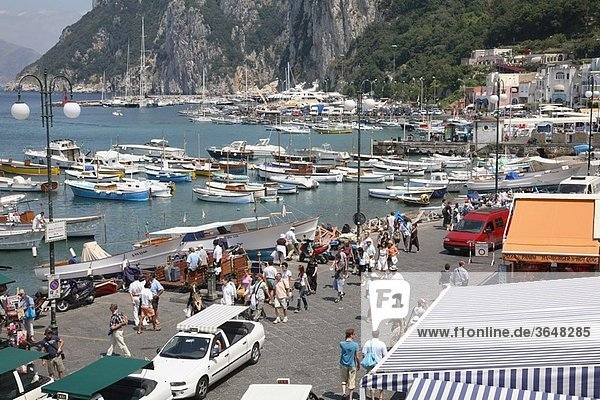 Visitors enjoy the sunny conditions at Marina Grande on the island of Capri in Italy