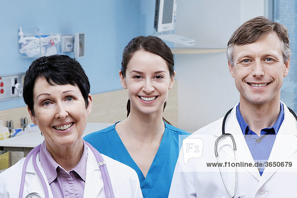 Portrait of two doctors and a nurse smiling