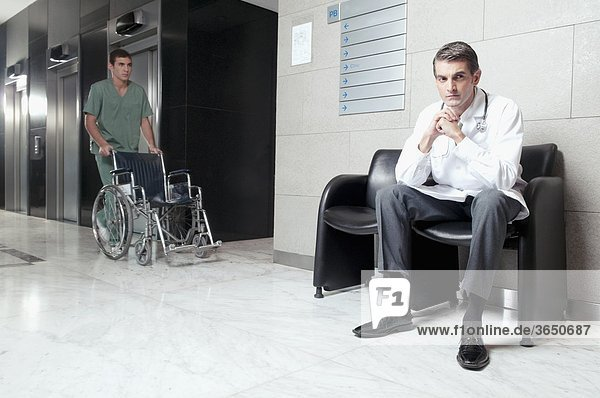 Doctor and a male nurse in a hospital