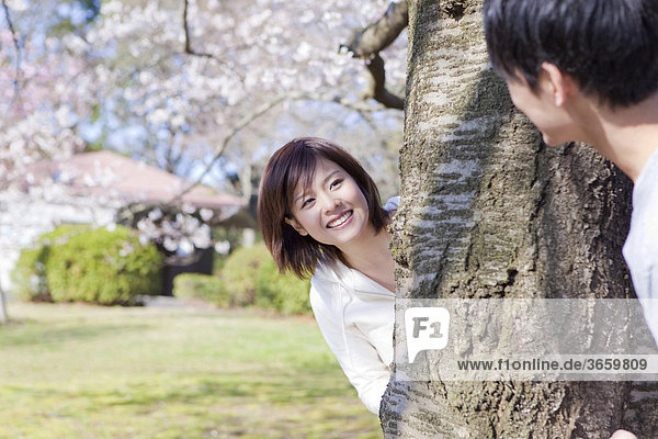 Young couple playing in park