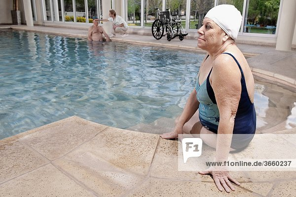 Woman sitting at the poolside