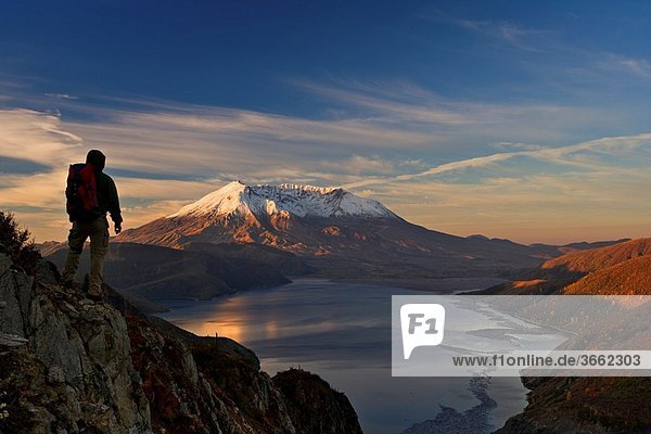 Hiker is enjoying view of autumn Mt St Helens volcano from near Independence pass