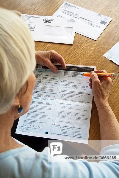 A woman fills out her 2010 U S Census form at home in California Administered every ten years  the census is an important tool of efficient government