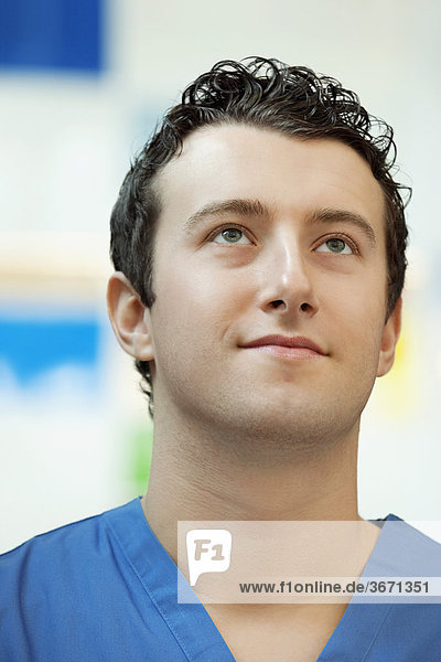 Close-up of a doctor thinking