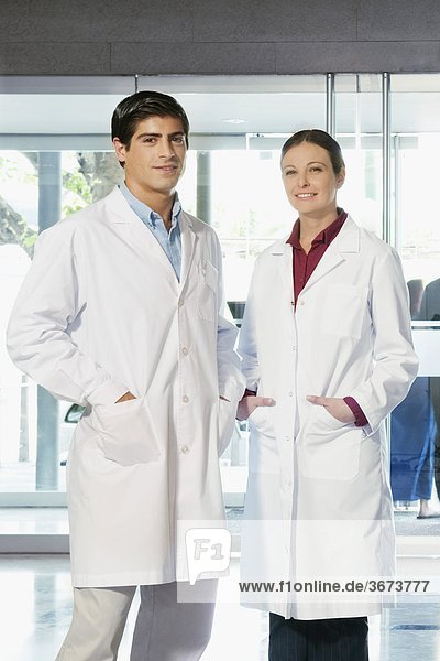 Portrait of two doctors standing together and smiling
