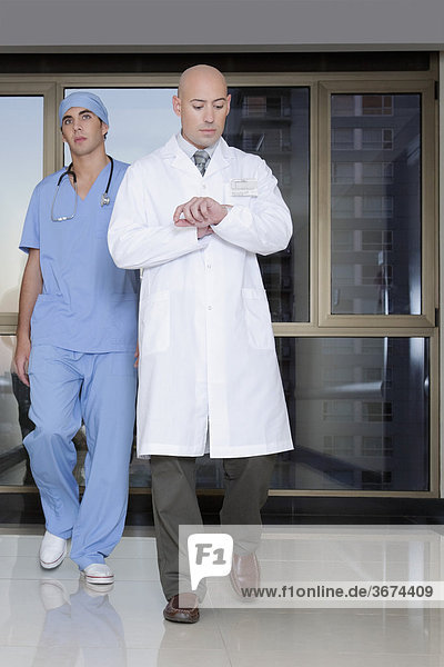 Doctor and a surgeon walking in the hospital corridor