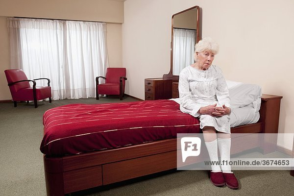 Woman sitting on the bed in a rehabilitation center