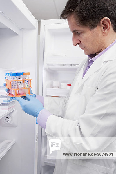 Doctor holding medical samples in a laboratory