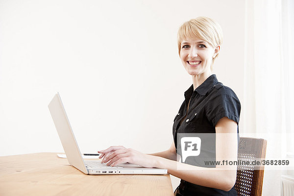 Young female using a laptop at home