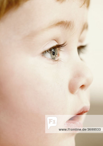 Close-up of a young boy looking away
