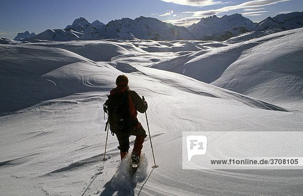 Woman on a snow shoe tour  on the Sennes-plateau  Fanes-Senes-Prags Nature Park  Dolomites  Italy  Europe
