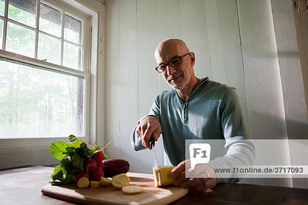 Senior man preparing food indoors