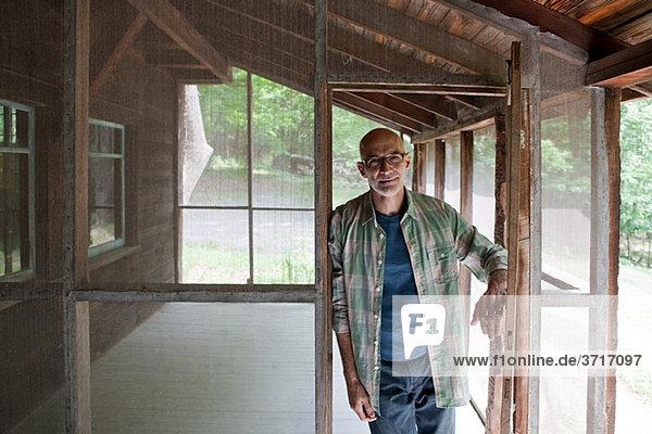Senior man on porch