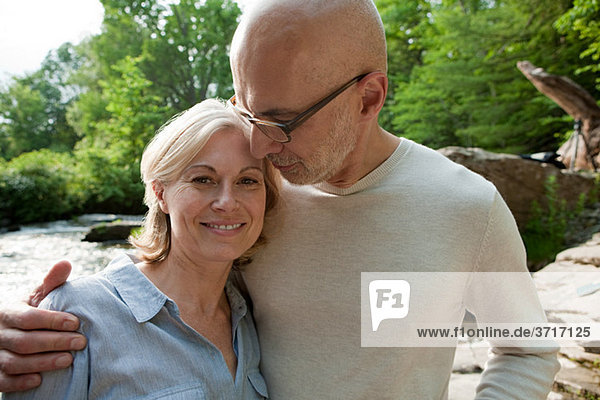 Mature couple outdoors in rural scene